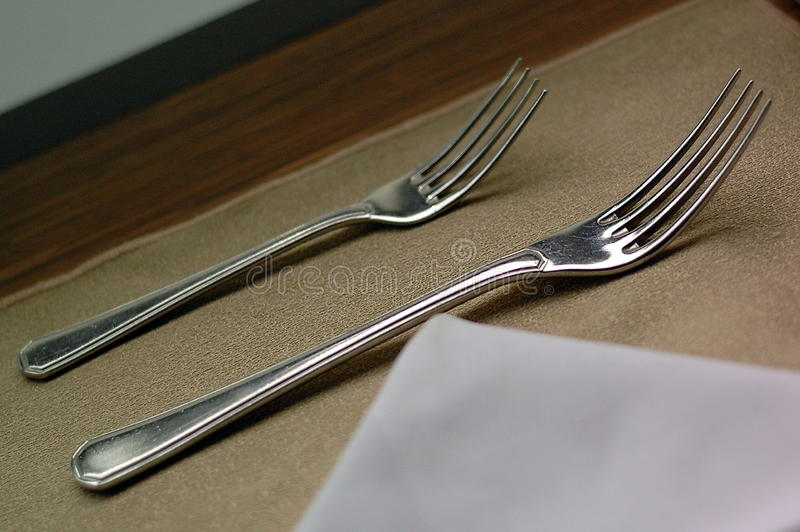 Double fork. Tableware fork is a device for use in food . Are important No less than spoon . Beautiful and shiny manufactured from stainless steel fine . Who can royalty free stock photo
