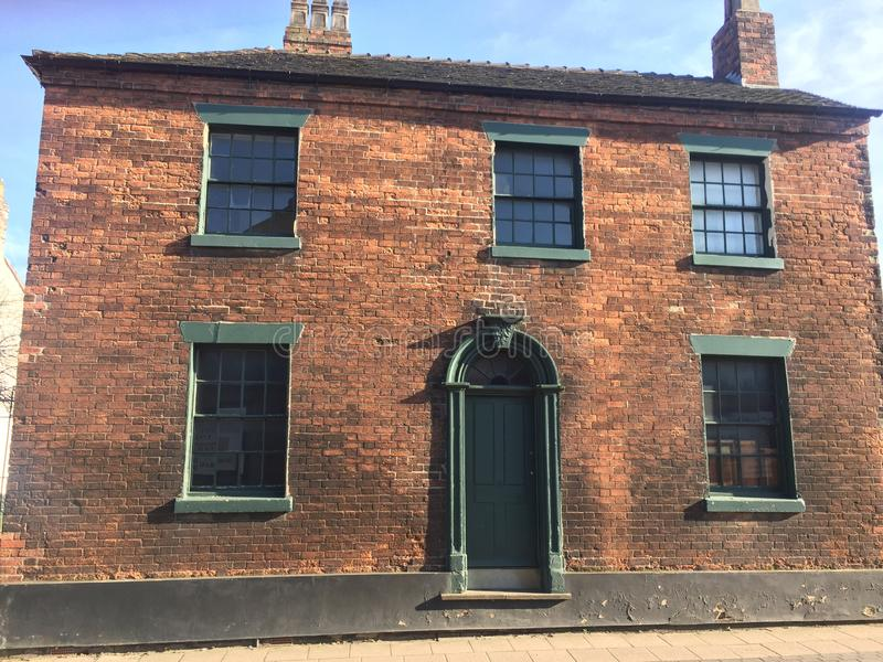 Double fronted victorian era brick building stock photography