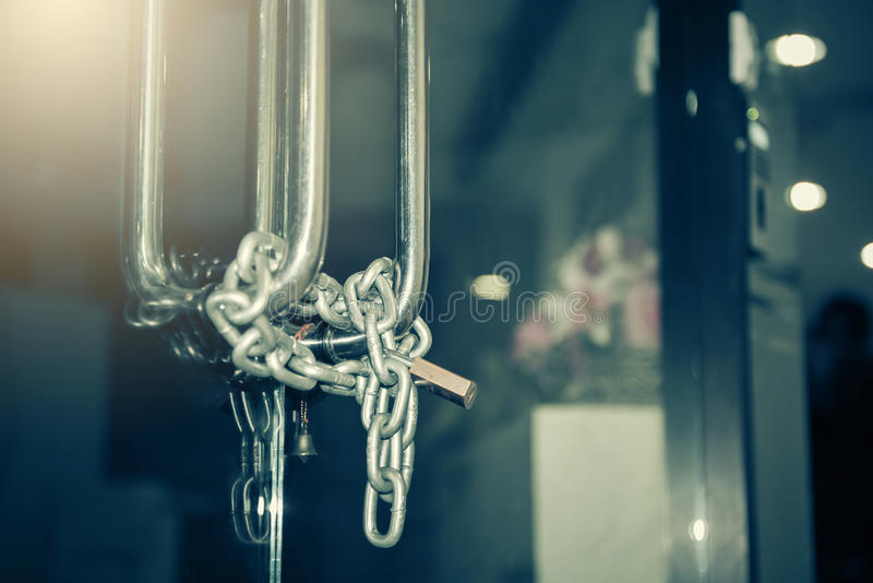 A double glass door chained closed stock images