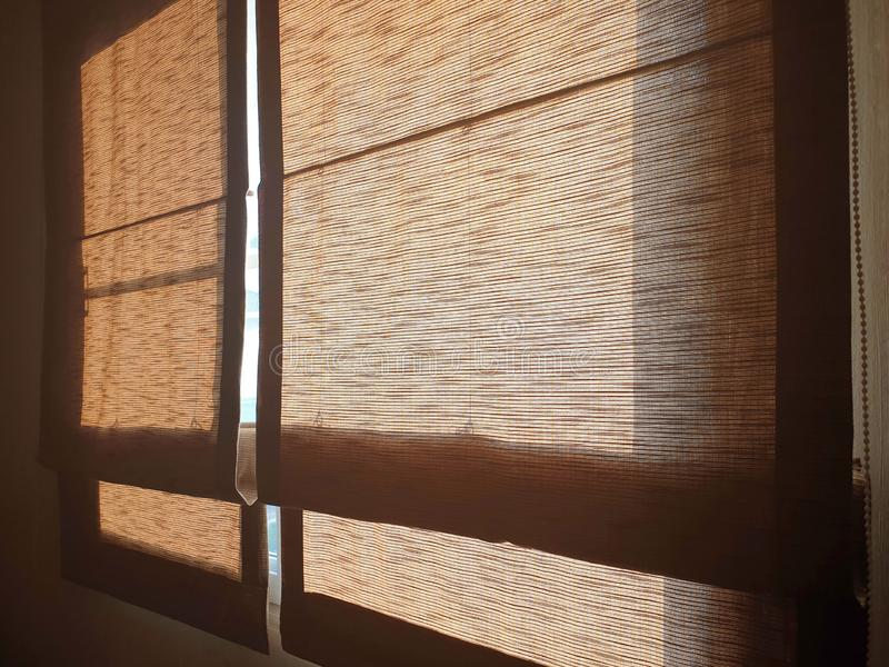 The double golden roman blinds. Helps prevent sunlight from entering the bedroom royalty free stock images