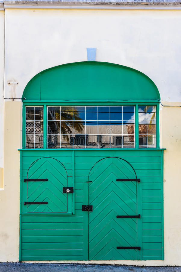 Double green door with archways and window reflection. In Christiansted St. Croix royalty free stock images