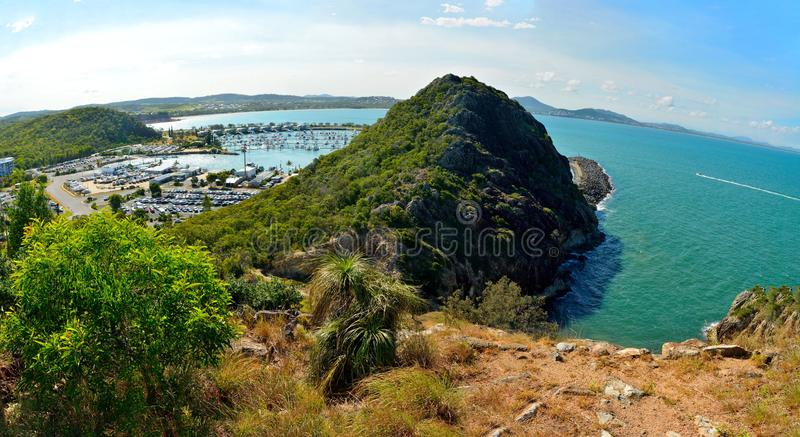 Double Heads volcanic outcrop protecting Rosslyn Bay Marina in R. View over northern section of Double Heads volcanic outcrop protecting Rosslyn Bay Marina in stock photography