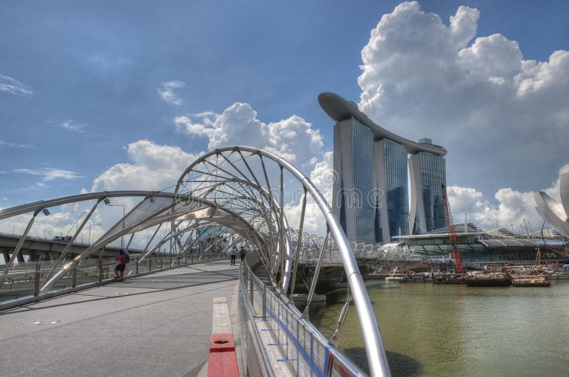 Double Helix Bridge to Marina Bay Sands. In Singapore stock photos