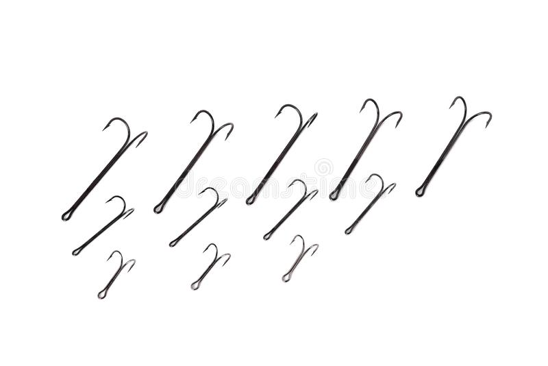 Double hooks for fishing of various sizes on a white background. Close-up stock image
