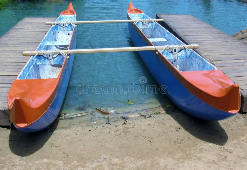 Double hulled canoe at jetty royalty free stock image