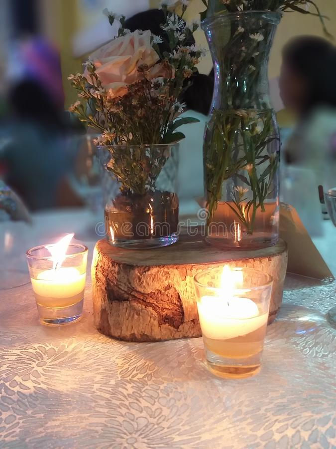 Double Impact. Glass, candle, picture royalty free stock photos