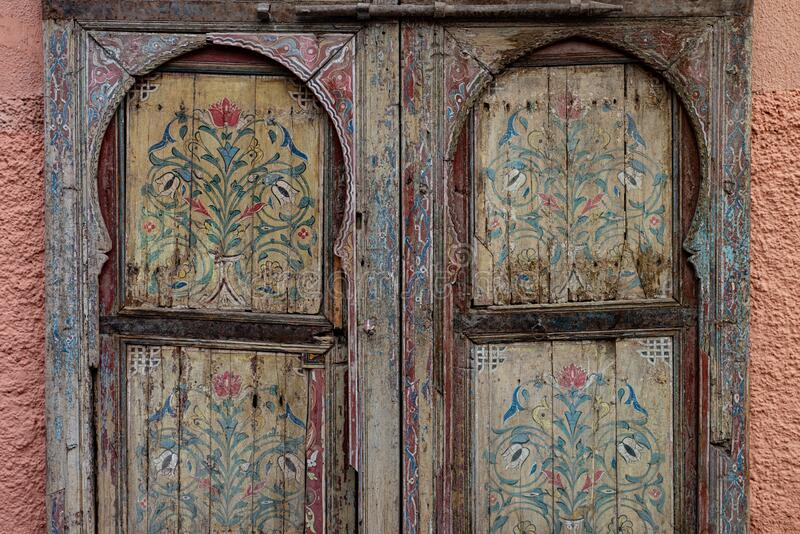 Double old wooden door decorated with flower drawing ornaments, Marrakech, Morocco. Double old wooden door decorated with flower drawing ornaments, Marrakech royalty free stock photo