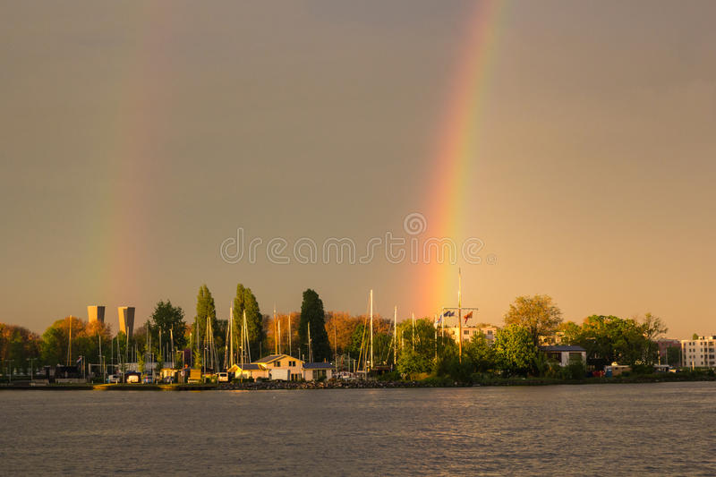 Double rainbow at Amsterdam bay. At sunset royalty free stock image