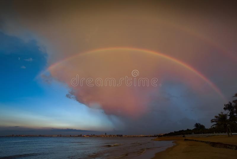 Double rainbow anging in the blue sky stock photos