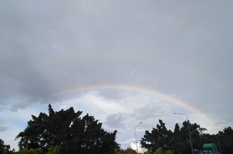 Double rainbow on gray sky stock photography