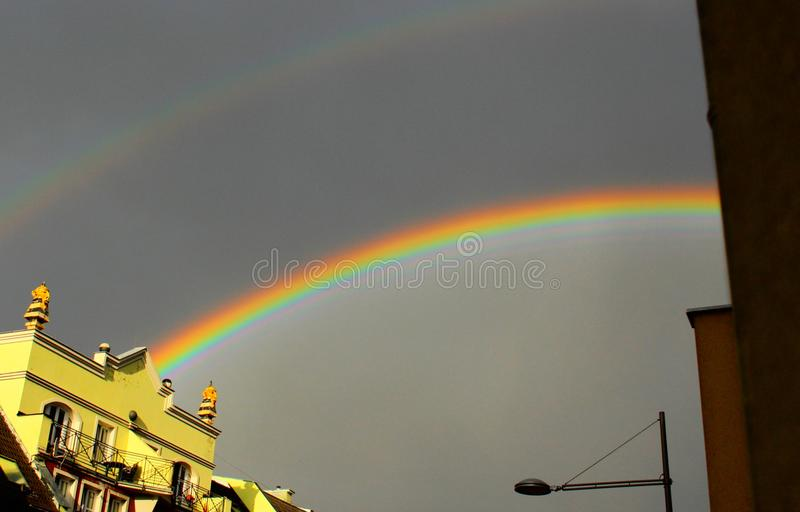 Double rainbow over the city. Gorgeous double rainbow over the city. View of rainbow from balcony. It is the first floor royalty free stock photography