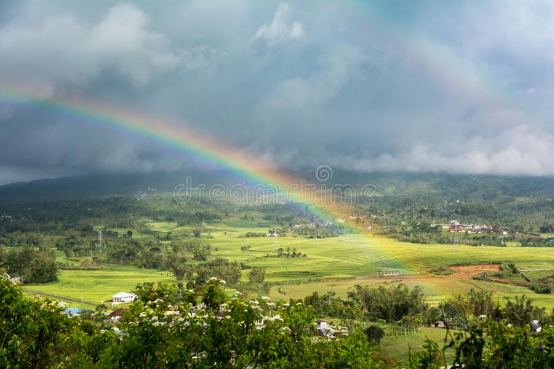 Double Rainbow Over Countryside with a Storm background. Ruteng, Manggarai Regency, Flores, East Nusa Tenggara, Indonesia royalty free stock photos