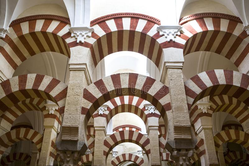 Double red-and-white colored arches inside Cordoba Mosque, Spain royalty free stock image