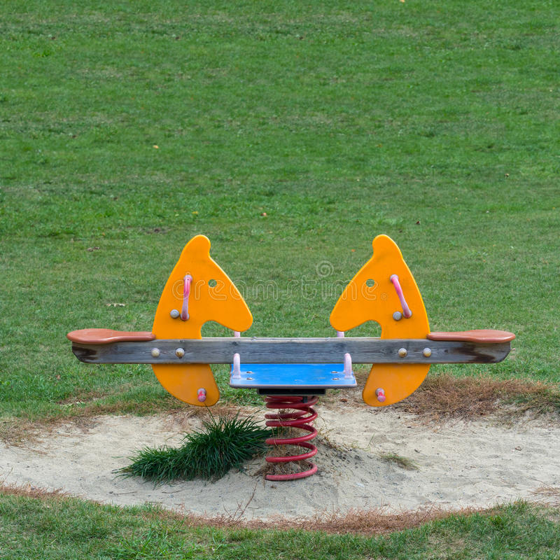 Double seats spring Horse in the meadow of a Playground stock photography