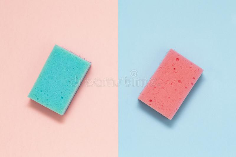 Double sided sponges for dishes on a multicolored background, minimalism. stock images