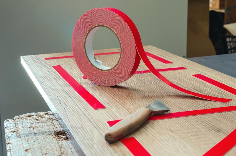 Double-sided tape, the master prepares the part for further sticking the mirror. Close-up royalty free stock images