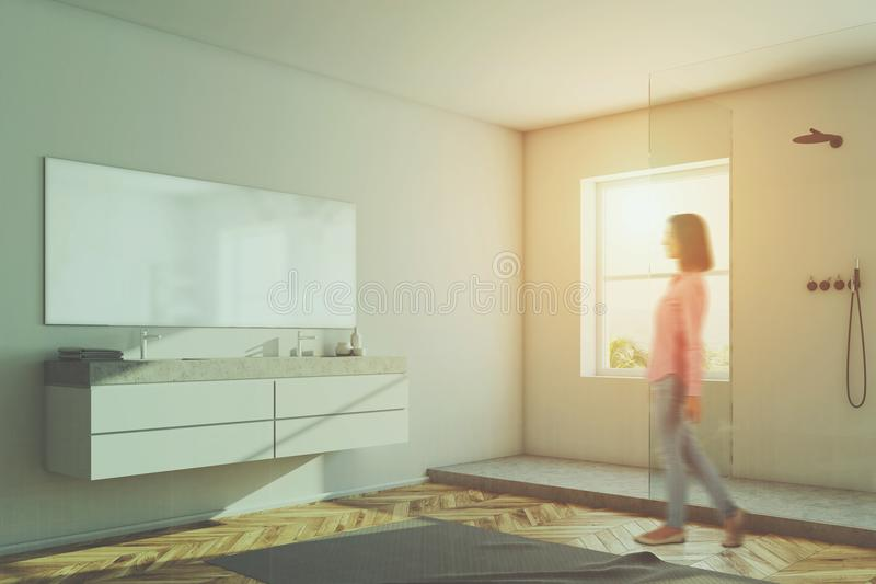 Double sink in a white bathroom, shower toned. Double sink and a shower stall in a white wall bathroom with a wooden floor and a carpet. A woman. 3d rendering stock image