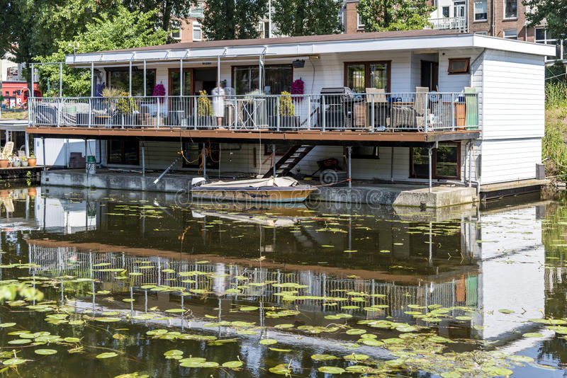 Double storey floating house. Floating house built on the water due to the global warming and the elevation of the water level around the world becomes reality stock photo