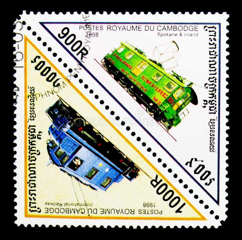 Double triangle postmark of Locomotives serie, circa 1998. MOSCOW, RUSSIA - NOVEMBER 24, 2017: A stamp printed in Cambodia shows Double triangle postmark of royalty free stock photography