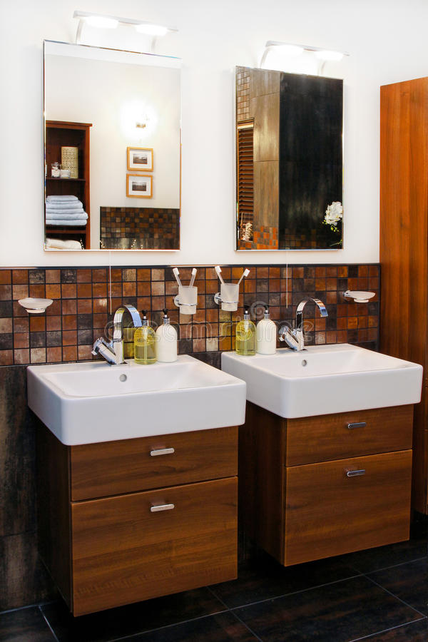 Double wash basin. His and hers wash basins in elegant bathroom royalty free stock photo