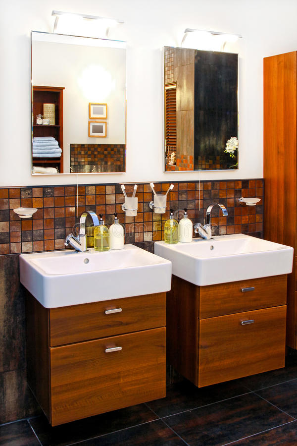 Double washbasin. His and hers wash basins in elegant bathroom royalty free stock photography