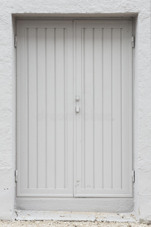 Double white painted wood exterior doors stock image for Wood doors painted white