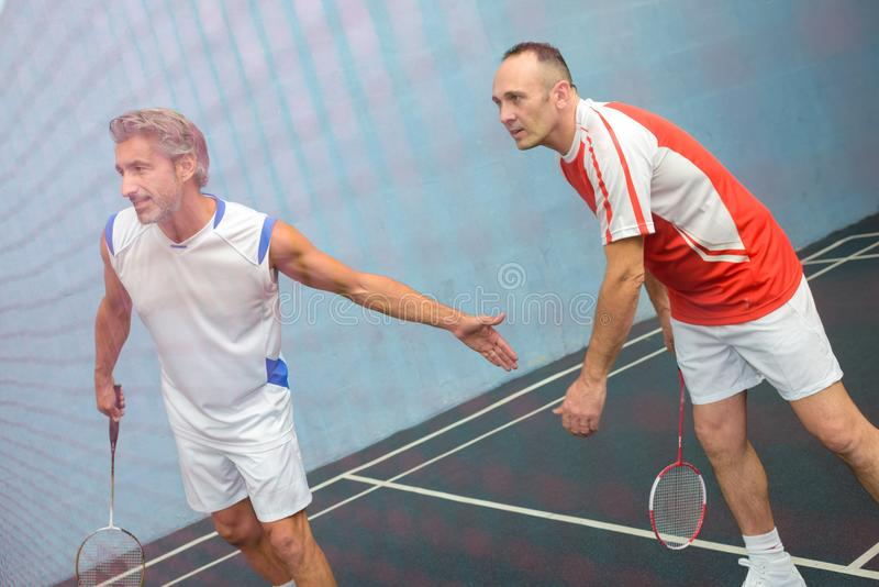 A doubles badminton game. Badminton royalty free stock photos