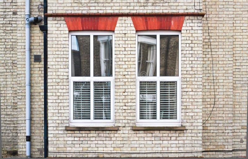 Doubles fenêtres de lustre photos stock