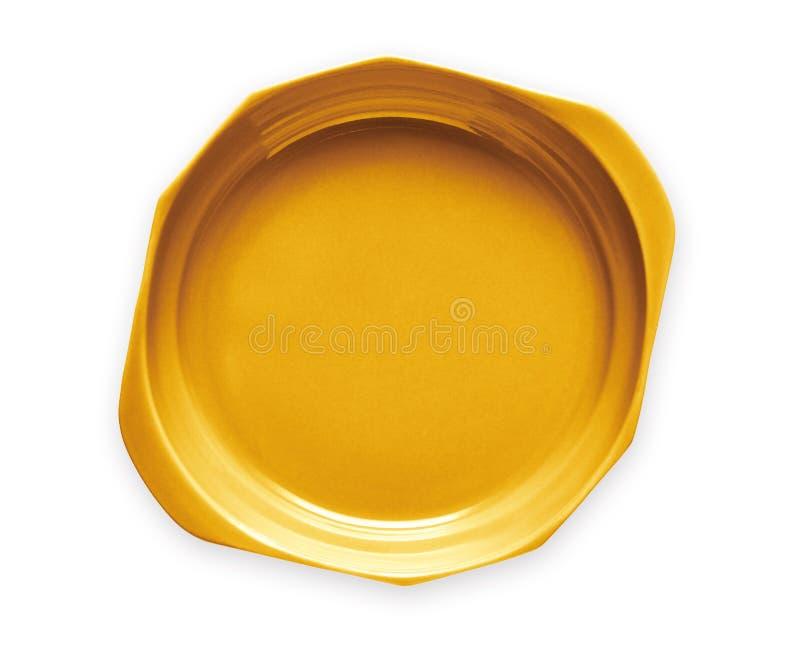 Doublez le plat manipulé, le plat jaune vide de céramique, vue d'en haut d'isolement sur le fond blanc avec le chemin de coupure photos stock