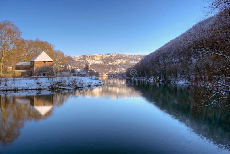 Doubs and Citadelle of Besancon. Doubs river with the Citadelle in background. France during winter. The fortifications were made by the architect Vauban royalty free stock images