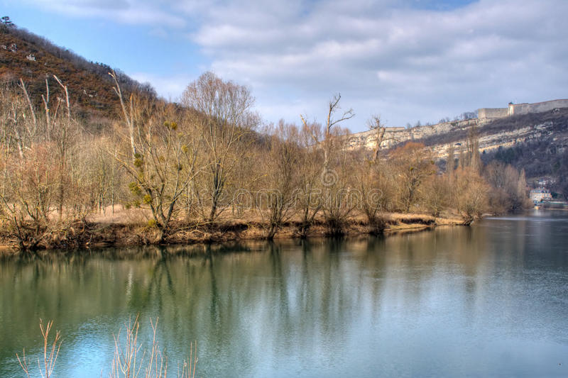 The Doubs River. Landscape of the Doubs river in Besancon, France. The citadelle or fortress is in the background royalty free stock photography
