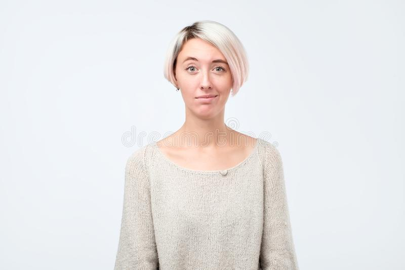 Doubt, mistrust, distrust concept. Doubtful woman looking with disbelief expression at studio. Young emotional woman. Human emotions, facial expression concept stock photography
