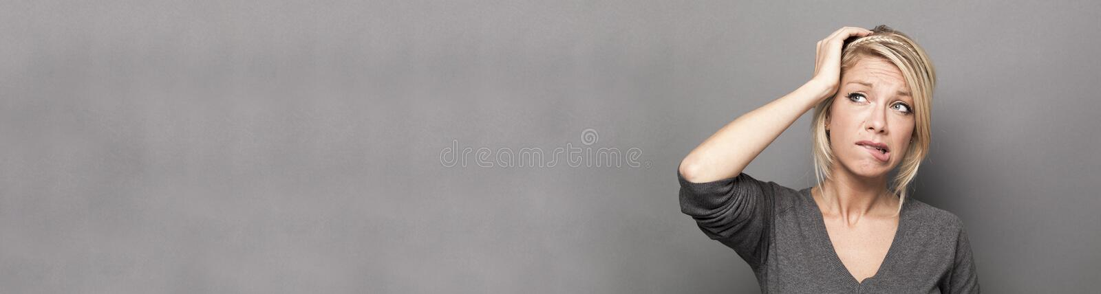 Doubt and worry concept for anxious young woman, copy space stock photo