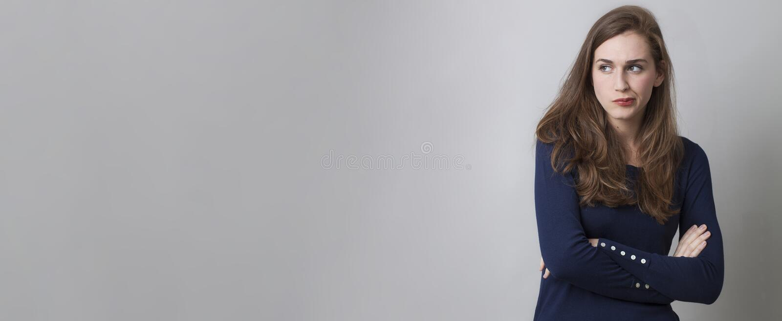 Doubt and worry concept with pouting young woman, long banner royalty free stock photos