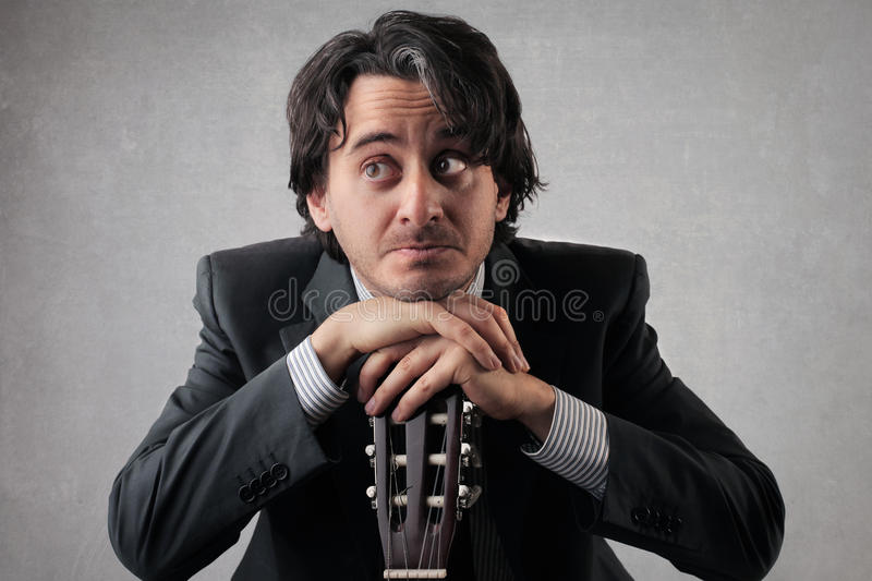 Download Doubtful Businessan With A Guitar Stock Photo - Image of singer, businessman: 39505012