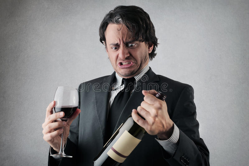 Download Doubtful Businessman With A Glass And A Bottle Of Wine Stock Photo - Image: 39504745