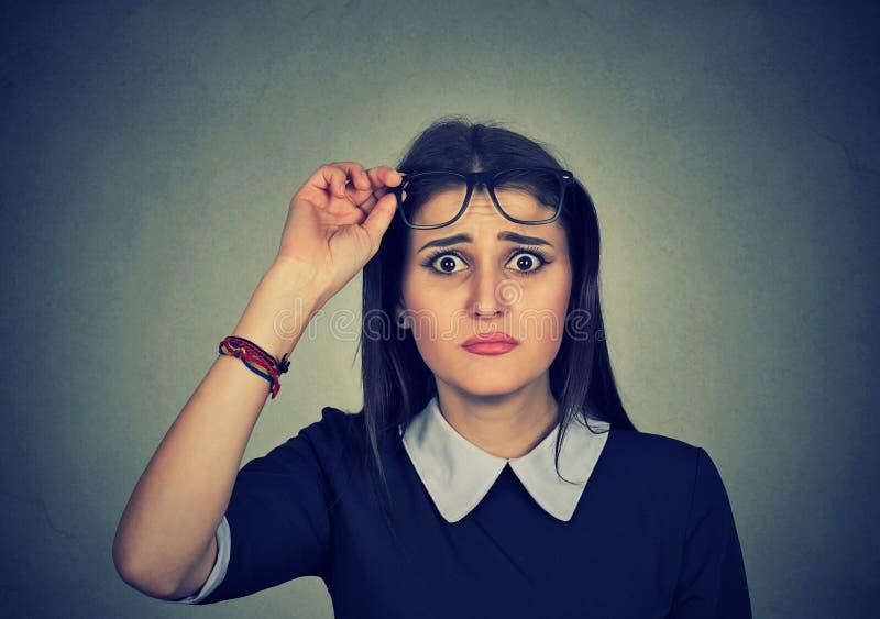 Doubtful girl looking at camera royalty free stock images