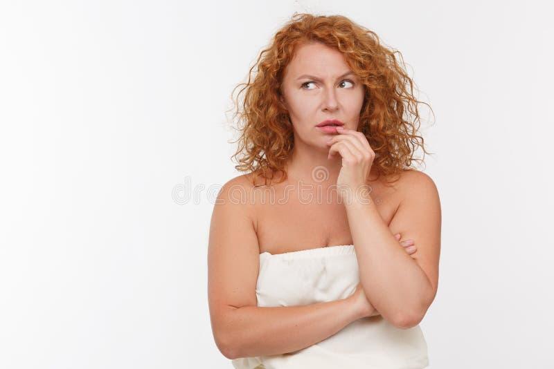 Doubtful mature woman royalty free stock photography