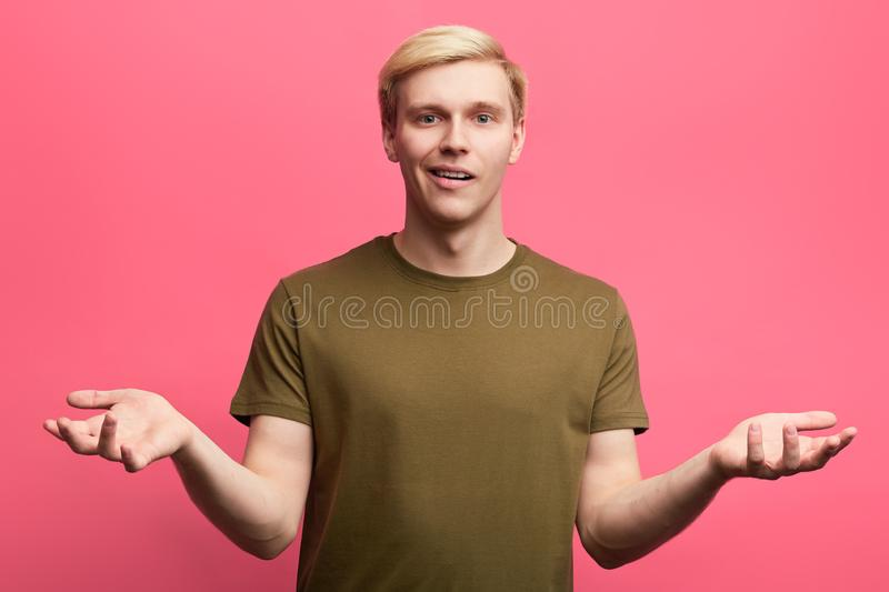 Doubtful puzzled man with shocked expression stock photography