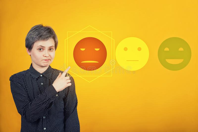 Doubtful woman hipster pointing index finger aside, uncertain face expression, choose negative feedback rating for bad customer. Doubtful skeptical woman royalty free stock photography