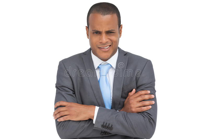 Download Doubtful Young Businessman With Arms Crossed Stock Image - Image: 31239355