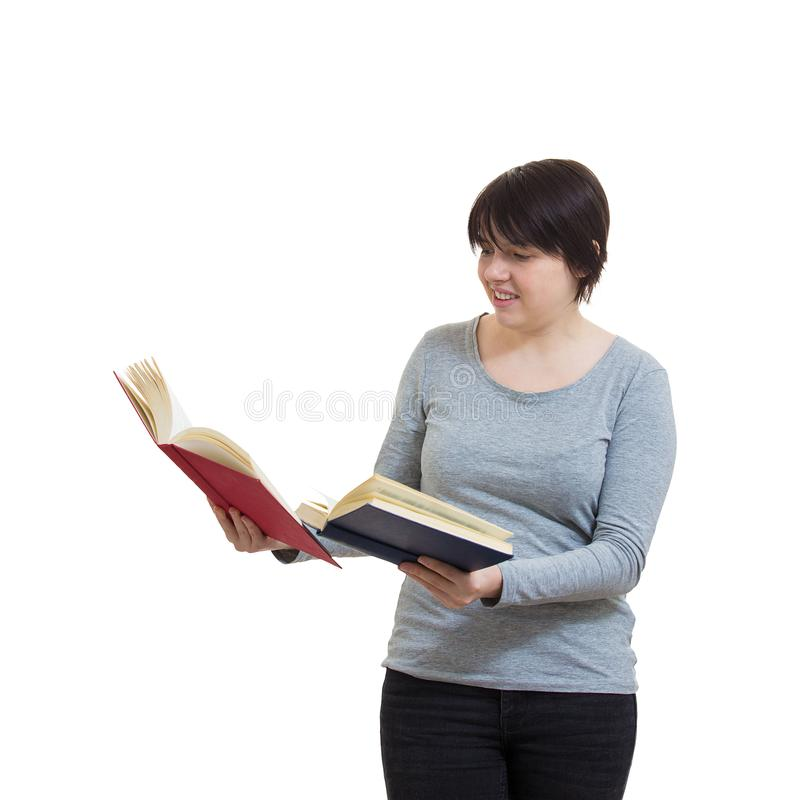 Woman compare books royalty free stock images