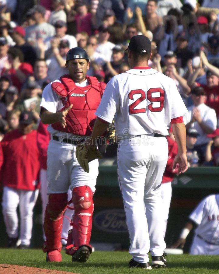 Doug Mirabelli. Boston Red Sox catcher Doug Mirabelli congratulates closer Keith Foulke on getting the save against Tampa Bay. Image taken from color slide stock images