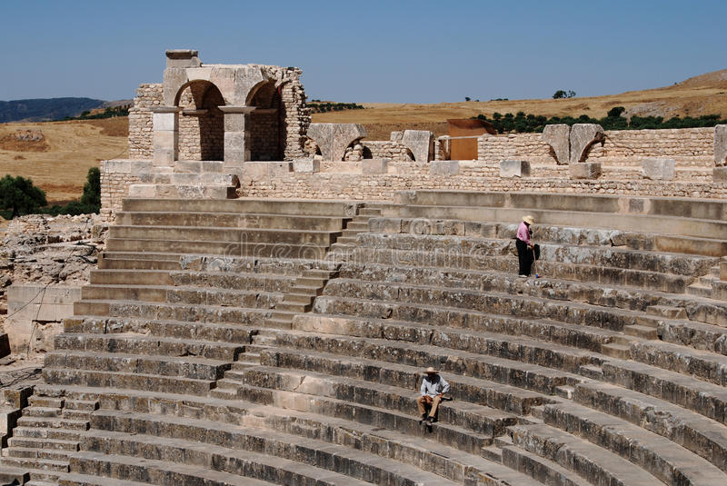Dougga Amphitheatre, Beja, Tunisia. Dougga or Thugga is an ancient Roman city in northern Tunisia, included in a 65 hectare archaeological site. UNESCO qualified stock images