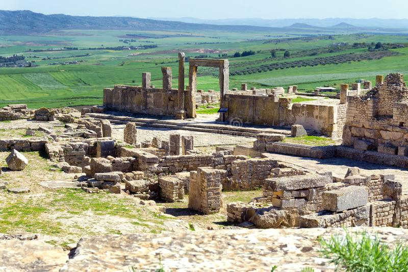 Dougga ruins in Tunisia. View of a section of the Roman ruins in Dougga, Tunisia with landscape in the background stock image