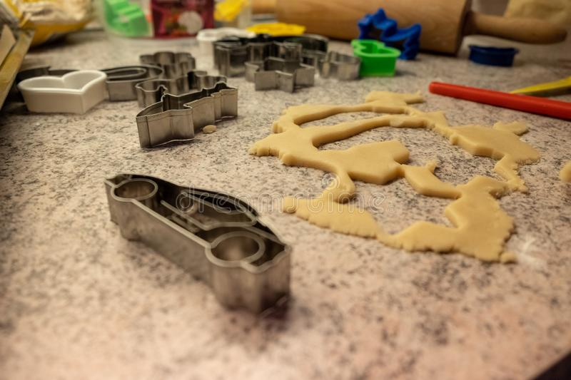 Dough and cookie cutter with a kitchen roll for baking cookies for christmas stock photography