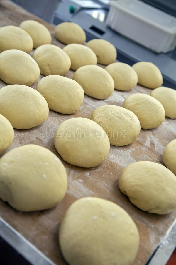Dough in fermentation to make sweet braided bread royalty free stock photos