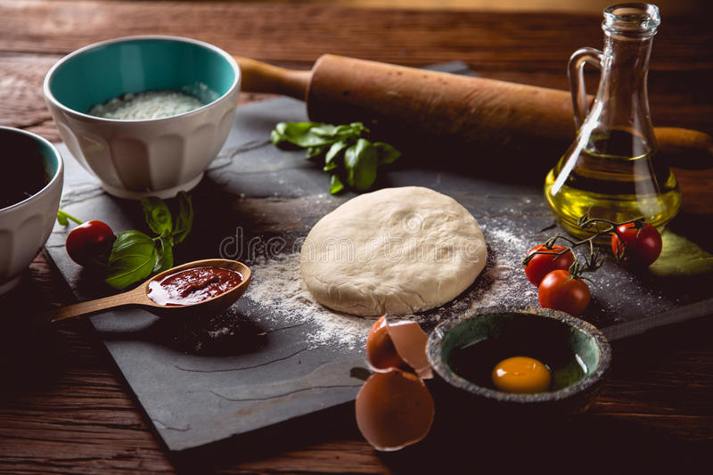 Download Dough With Flour On Wooden Table, Preparing Homemade Pizza Stock Photo - Image: 83723079