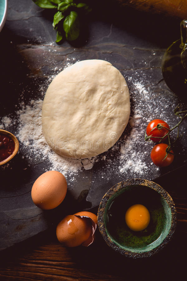 Download Dough With Flour On Wooden Table, Preparing Homemade Pizza Stock Image - Image: 83723163