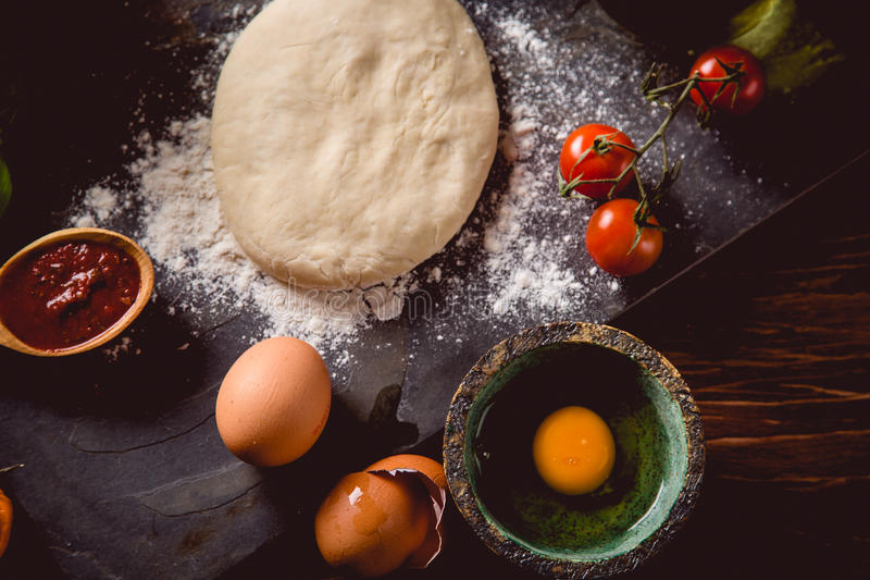 Download Dough With Flour On Wooden Table, Preparing Homemade Pizza Stock Photo - Image: 83723263